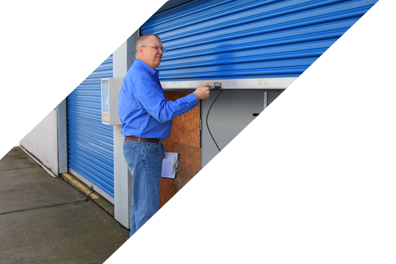 Photo of Service Representative locking the door to a storage container